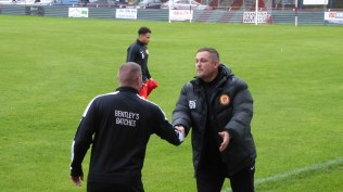 The two managers shake hands before the match; a fine gesture that was repeated after the sporting match.