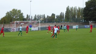 Early in the game and the Wood defend their goal. Unusually the home keeper wore blue and green, while Coventry's keeper wore green top and shorts.