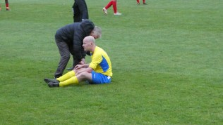 First half and a visiting player receives attention. He was a solid ,consistent sportsman today.