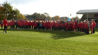 Walsall Wood Saints gather to commemorate Armistice 1918 in a moving pre-match tribute.