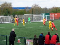 Early first half action as Romulus, in red, attack the Wood's goal.
