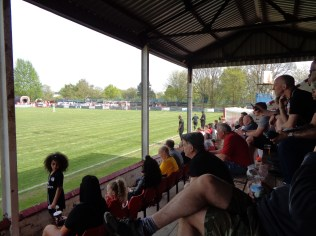 The stand soon filled up with enthusiastic spectators from both clubs, eager to see their team win.