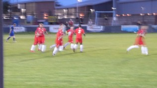 in a blur the Wood players are keen to get on with the job after scoring their first goal