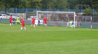 Highgate barge their way through to score a bruising equalising goal.