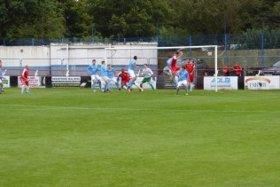 Wood on the attack as Pegasus defend well.