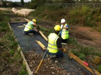 BT volunteers laying the timber edging and hardcore of the Heritage Towpath Trail at Summerhill