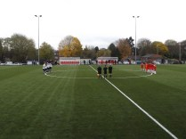 One minute's Remembrance silent tribute before the kick off on this flat new synthetic grass pitch