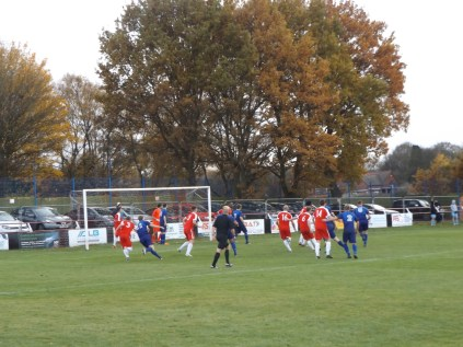 The Wood in maximum defence mode as the Swifts launch another from a corner kick.