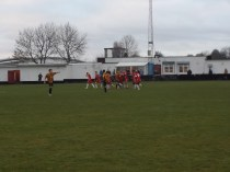 Positive team spirit evident in both sides. And seen here as the Wood celebrate scoring a goal