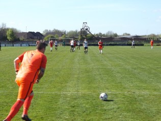 Second half and a strong goal kick launches another attack as Heanor prepare to defend