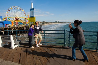Tourists taking pictures on the Santa Monica Pier, Santa Monica, California, United States of America