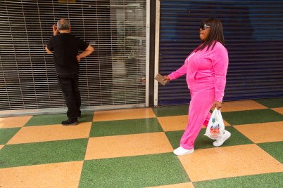 Lady in pink walking, Broadway, downtown Los Angeles, California, United States of America-
