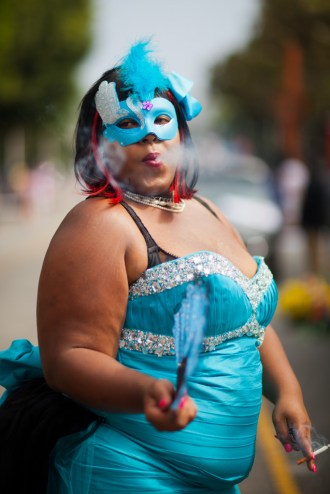 Woman in mask smoking, 2014 Gay Pride Parade, West Hollywood, Los Angeles, California, USA