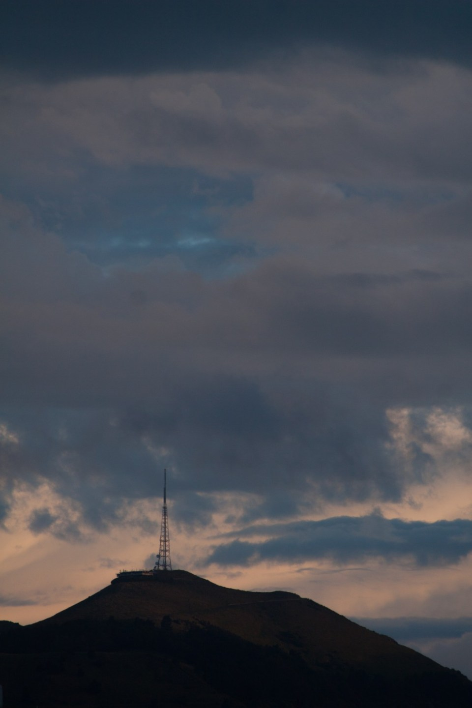 moody clouds above a tv mast / transmission tower