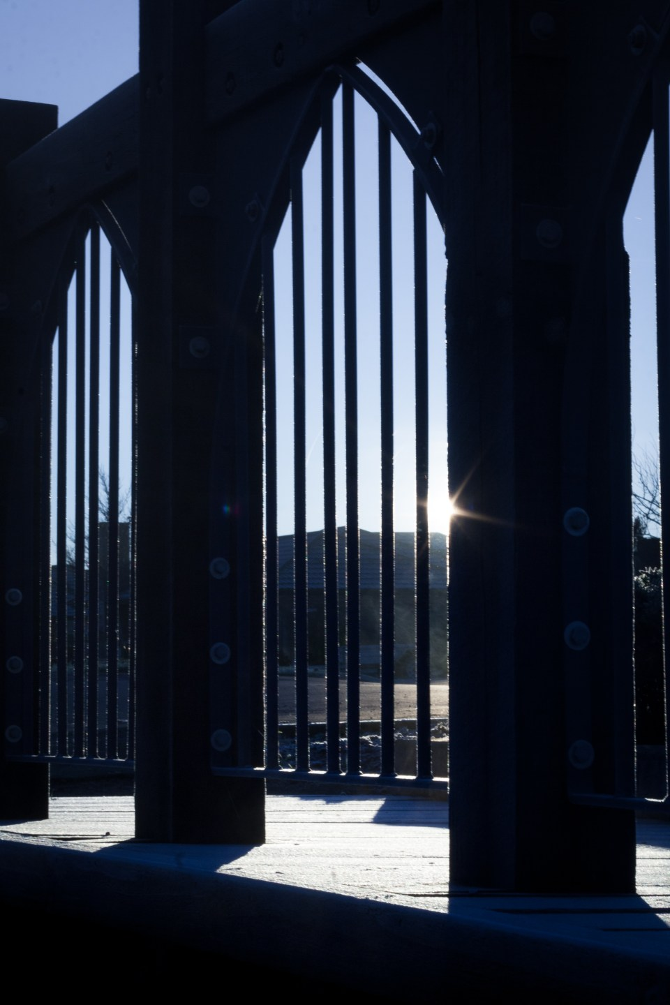 looking at the sun through bridge structure on a frosty morning