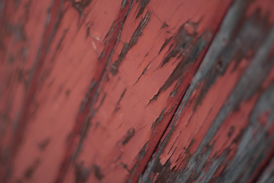 wooden slats with peeling red paint