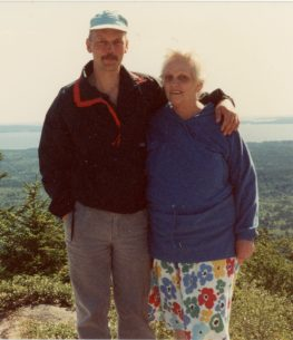 Son and mother at mountain top.