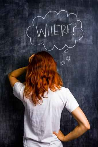 Frustrated redhead woman asking where