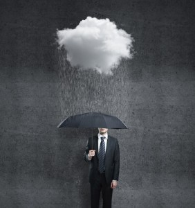 businessman with umbrella and rain
