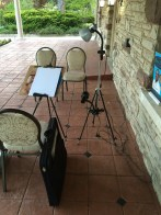 Bruce's caricature setup on the terrace