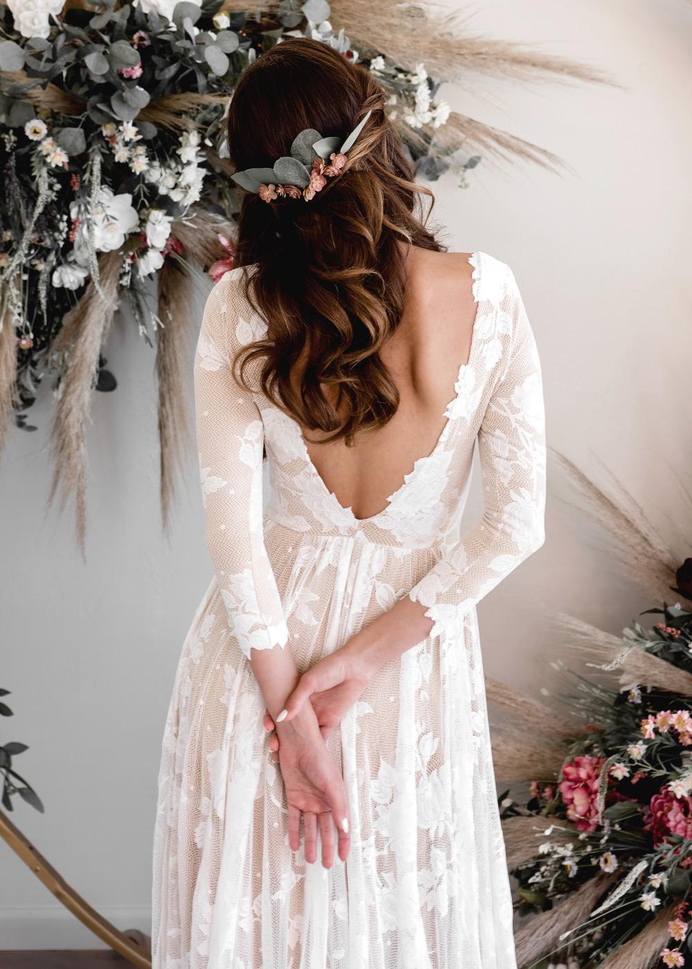 Bruid met tweedehands trouwjurk