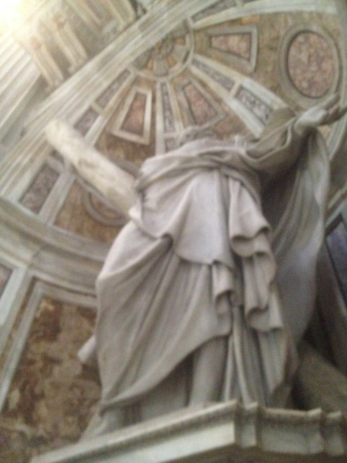 This statue is above a stairwell that leads into a tunnel system under the basilica.