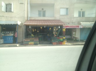 This is a fruit stand near our home. I like the way they used bananas to decorate the front of their store.