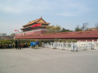 A garden area next to Tiananmen Square. Beyond the building with the picture of Mao is the Forbidden City.