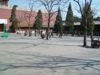 Soldiers do martial arts just beyond the entrance to the Forbidden City.