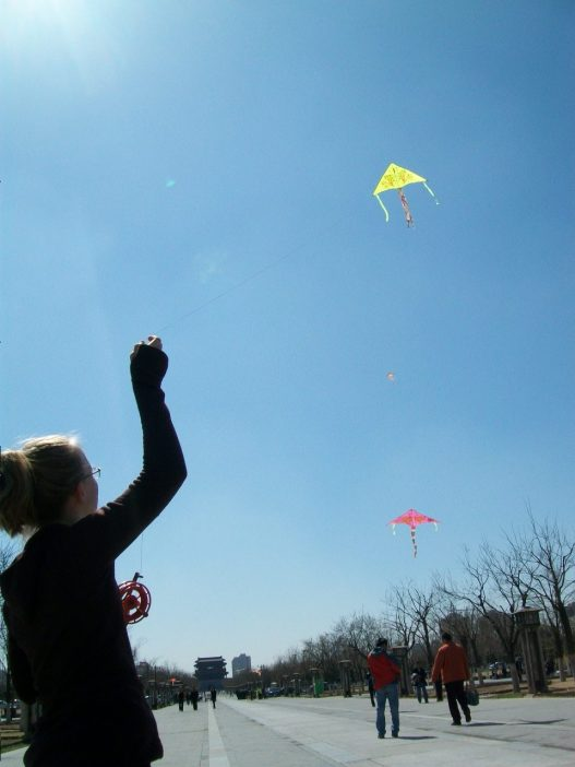 Lydian gets her green kite up in the air at Yongdingmen.
