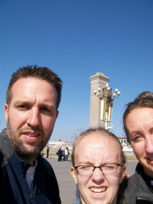A selfie we took facing into the sun in front of the Monument to the People's Heroes.