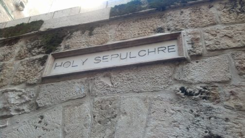 The sign indicating the walkway toward the Church of the Holy Sepulchre.