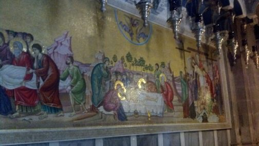 A picture behind the Stone of Anointing depicting Jesus' preparations for burial.
