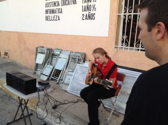 Lydian tuning her guitar for an event at the Centro de Idiomas in Progreso, Yucatan.