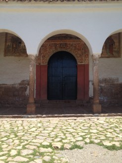 The front of the church with the mural at the Saksaywaman ruins.