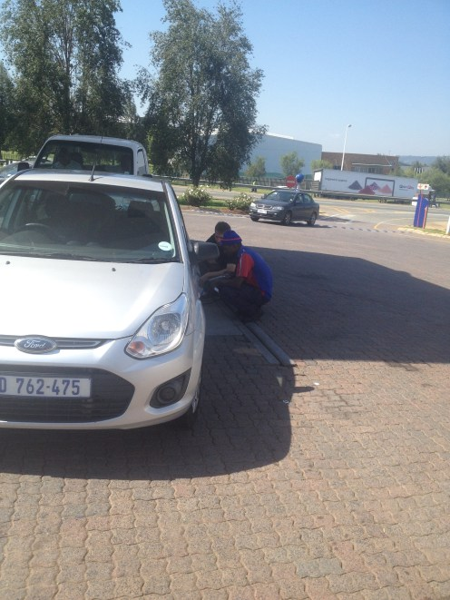 Analyzing our rental car before taking off to our Johannesburg vacation rental.