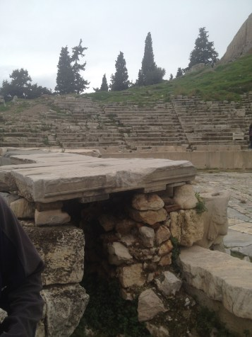 Next to the Propylon of the Sanctuary of Dionysus is the Theater of Dionysus at the Acropolis in Athens.