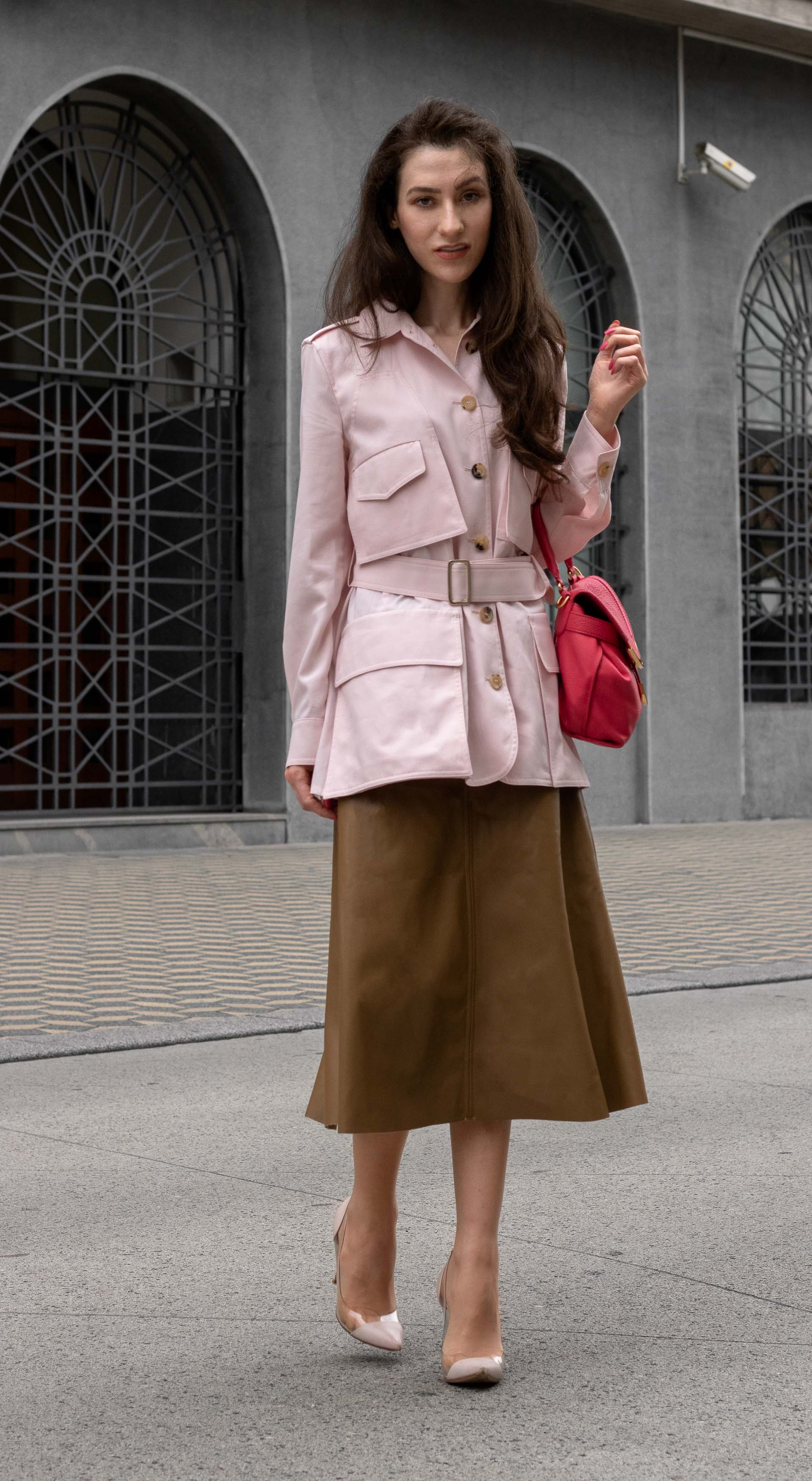 Fashion blogger Veronika Lipar of Brunette from Wall Street wearing Max Mara safari jacket H&M leather midi skirt Gianvito Rossi pumps for work in fall