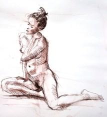 Fabienne assises tête penchée