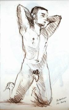 Damien à genoux, mains sur la tête