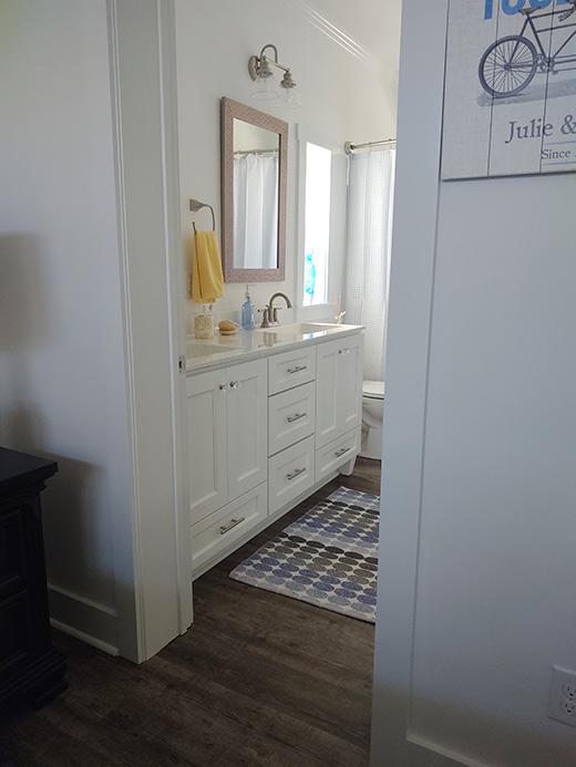Bright White Bath Cabinets and Countertops