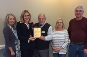 Plaque presented to Michelle Griffin, Chair of the Ocean Isle Beach Flotilla and Debbie Tucker OIB Flotilla committee member by Mr. Bill Hadesty, BFA Chairman; Steve Long Vice Chairman and Sue Brandon, Secretary