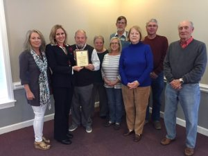 Plaque presented to Michelle Griffin, Chair of the Ocean Isle Beach Flotilla and Debbie Tucker OIB Flotilla committee member by Mr. Bill Hadesty, BFA Chairman; Steve Long Vice Chairman and Sue Brandon, Secretary and Board members Rev. John Causey, Karla Squire, Len Bernauer and Jayne Mathews