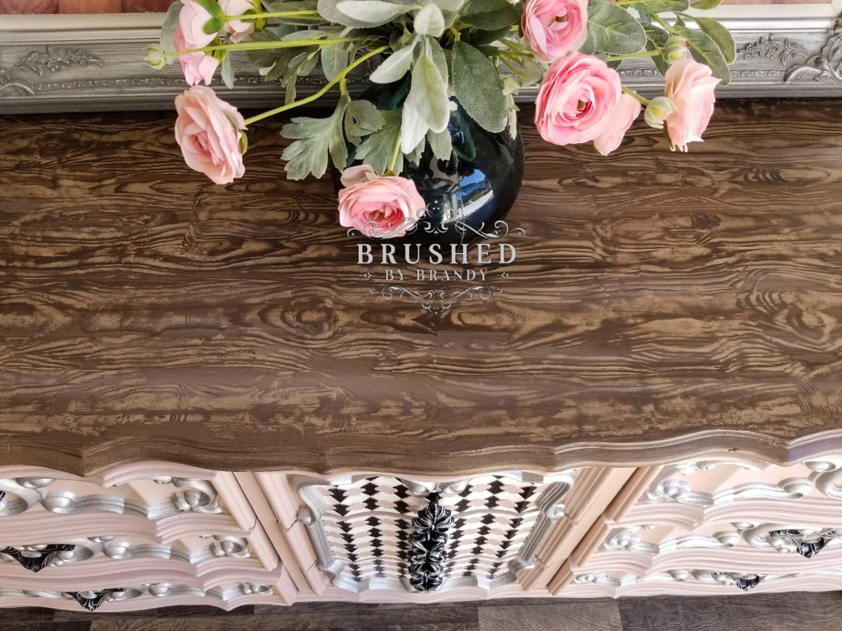 How to Create a Faux Wood Finish Pink Detailed Dresser top Brushed by Brandy