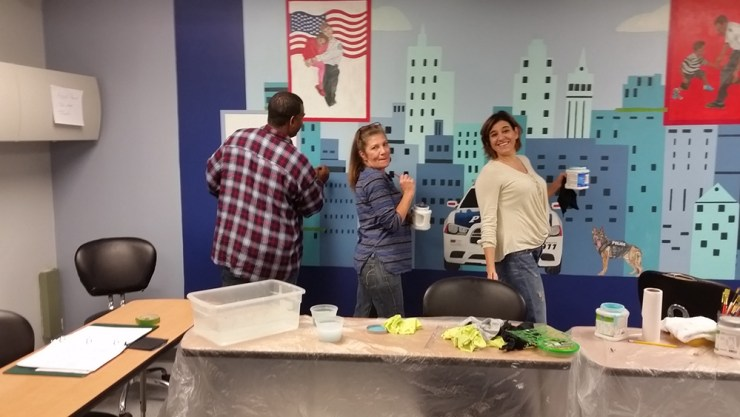painting mural at police station for community service