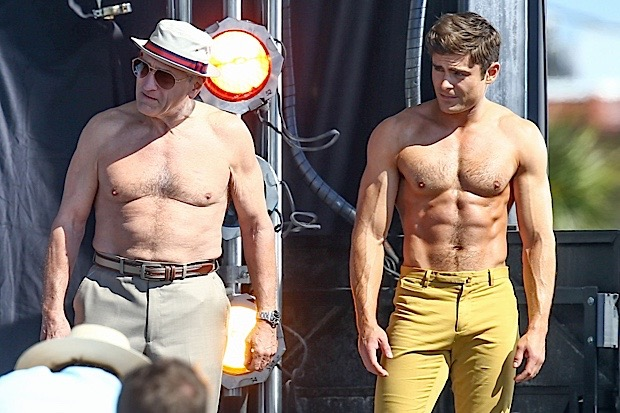"""Actors Zac Efron and Robert De Niro take off their shirts for a """"Flex Off"""" contest for a scene in their new movie """"Dirty Grandpa"""""""