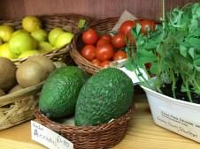 Avocados, tomatoes, kiwis, lemons, and pea shoots
