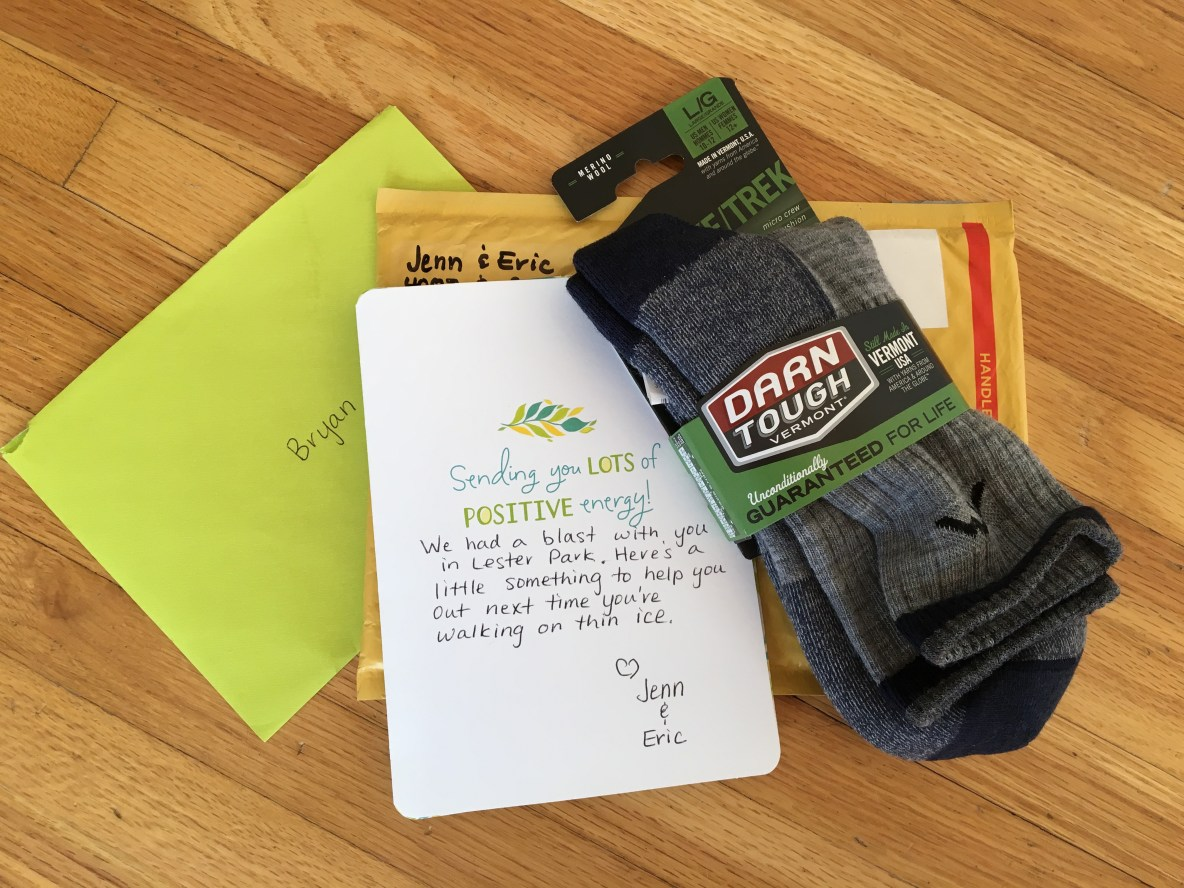 Photo of a gift from the couple-- a pair of wool socks and a handwritten note.