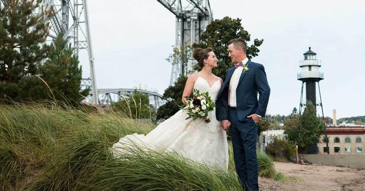 Bride and groom photo with lift bridge in background.