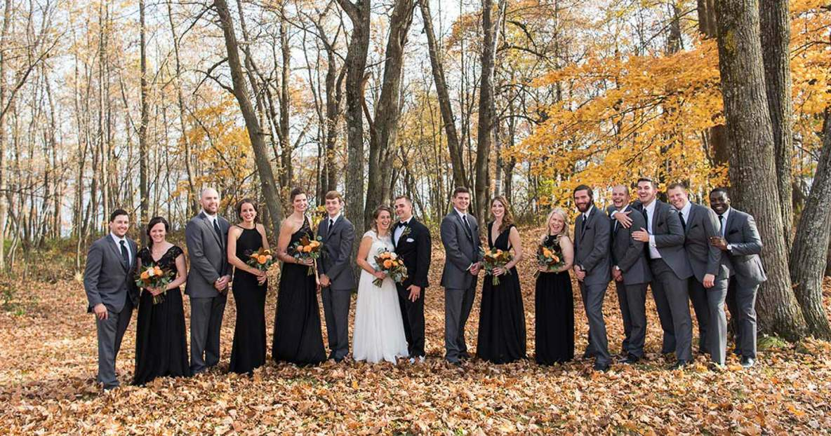 Wedding party photo outside in the fall colors.